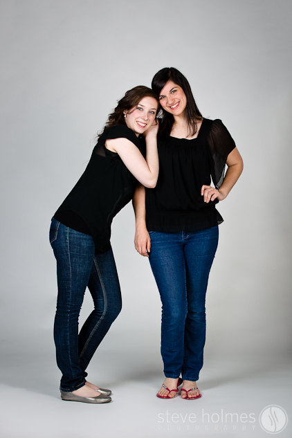 Two friends having fun in the studio during their senior portrait session.