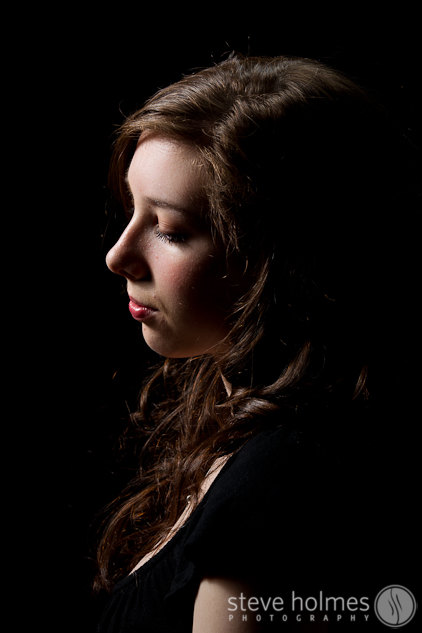 Samantha poses for a portrait in the studio with some dramatic lighting.