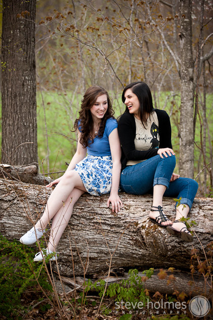 A candid potrait of two friends during their high school senior portrait session in Keene.