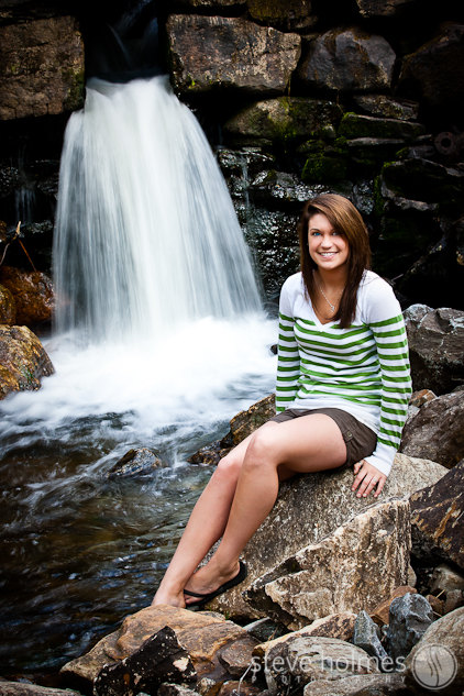 Outdoor portrait of a high school senior by the old mill waterfall in Alstead, NH.