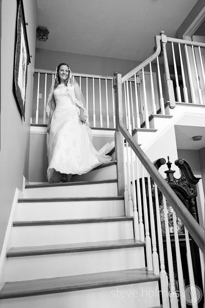 Ashley walking down the steps of her home ready for her wedding day.