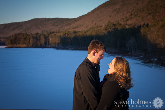 Hannah & Alex laughing with Surry Mountain in the background.
