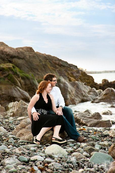 Engagement portrait on the cobblestone beach.
