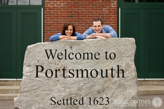 Engagement photo in front of the welcome to Portsmouth sign.