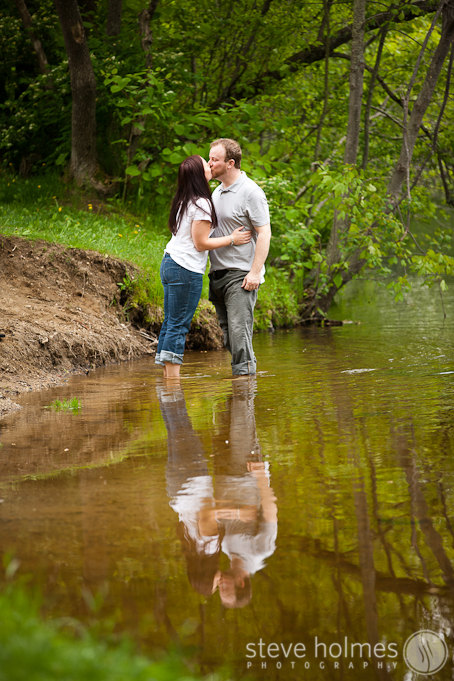 Couple kissing in the river during their engagement session in Keene, NH.