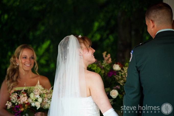 Bride smiling at the groom.