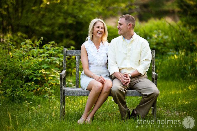 Engagement session portrait on a park bench.