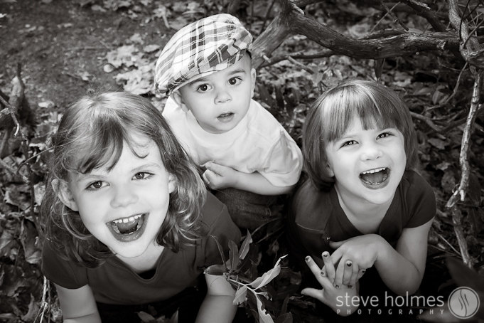 This photo is one of my favorites. I always like to play and have fun when I'm photographing kids, and this photo shows their reaction when I stuck my head in the bushes during a game of hide and seek.