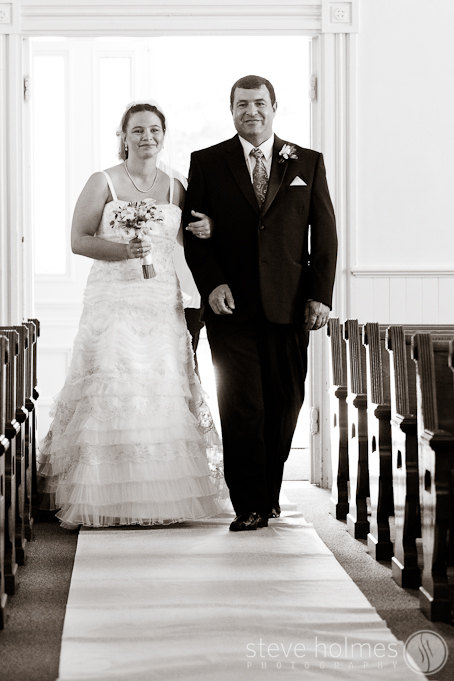 Father walking his daughter down the aisle.
