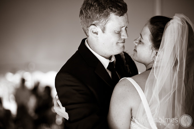 An intimate moment during a couple's first dance at their wedding reception.