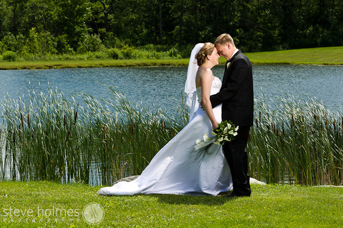 Katie and Josh by the pond at the ceremony site.