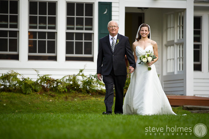 Lisa's father walks her down the aisle