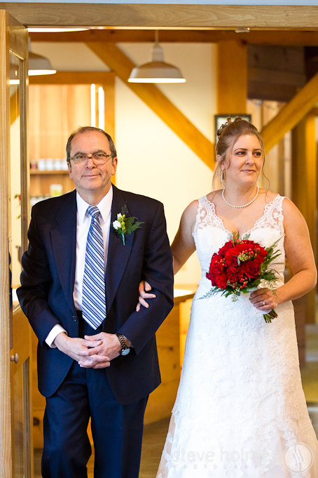 Suzanne's father walking alongside his daughter down the aisle