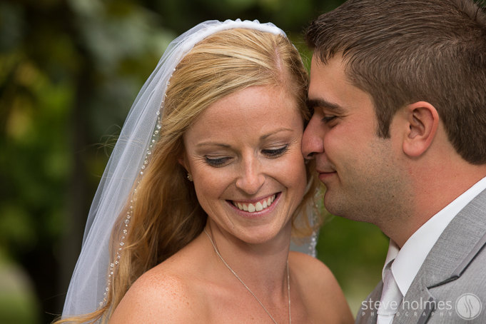 A sweet moment between Jenny and John during their portraits