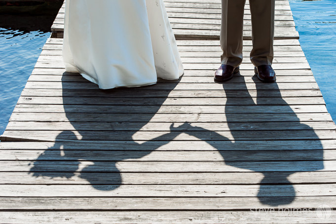 The bride and groom's silhouettes in the afternoon sun