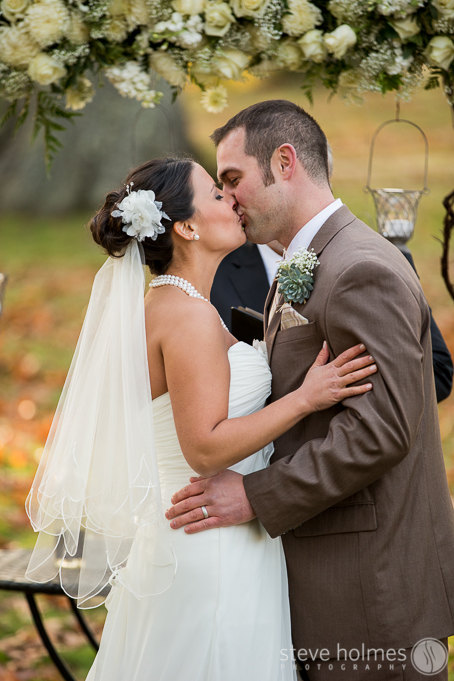 Meghan and David share their first kiss as husband and wife.