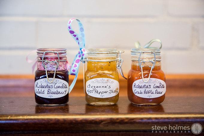 Caroline and David's wedding favors were home made jam jars