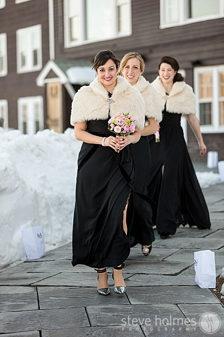 The bridesmaids kept warm during this winter wedding with fur coats.