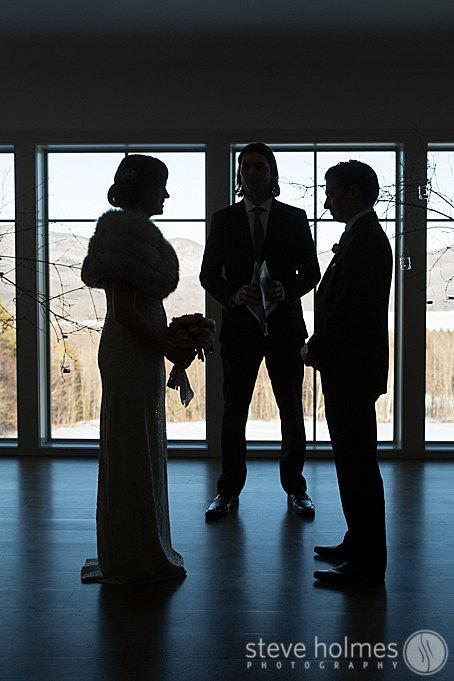 Creative shot of the couple during the ceremony with mountain views in the background.
