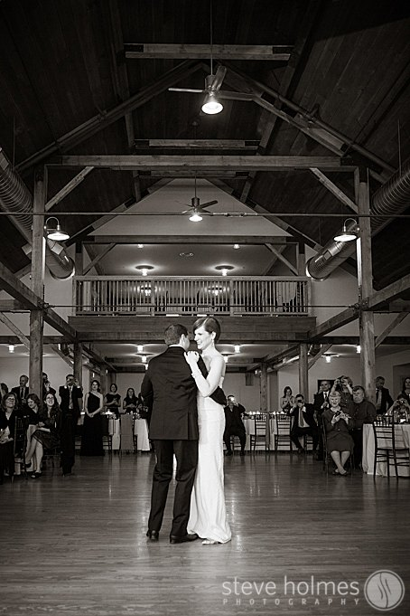 The couples first dance photo in black and white.