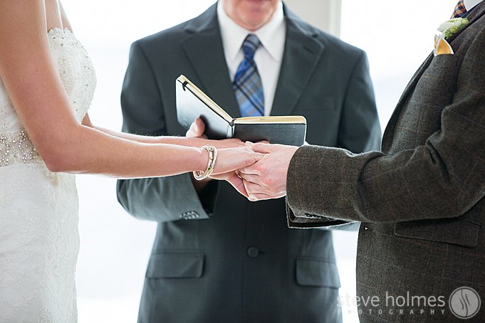 A close up of the bride and grooms hands during their wedding ceremony in Vermont at The Mountain Top Inn & Resort