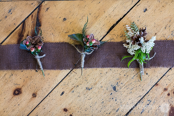 A neutral boutonniere finished with twine.