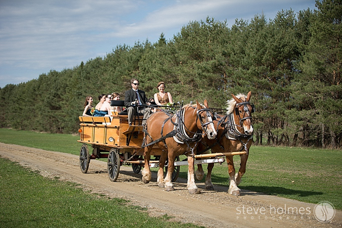 The bridal party arrives in style for the ceremony at Alyson's Orchard!