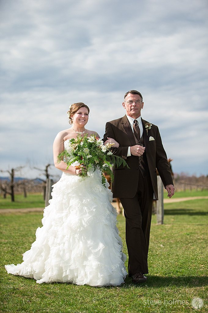 The bride and her father walking down the aisle at Alyson's Orchard.