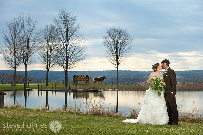 You can see why, as a destination wedding photographer, this is one of my favorite locations!  The serene pond at Alyson's Orchard with the horse drawn carriage in the background.
