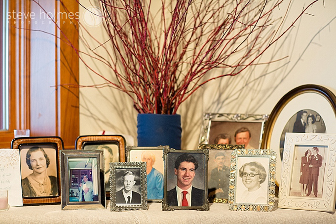 A nice touch to include portraits of the couples family members at the reception.