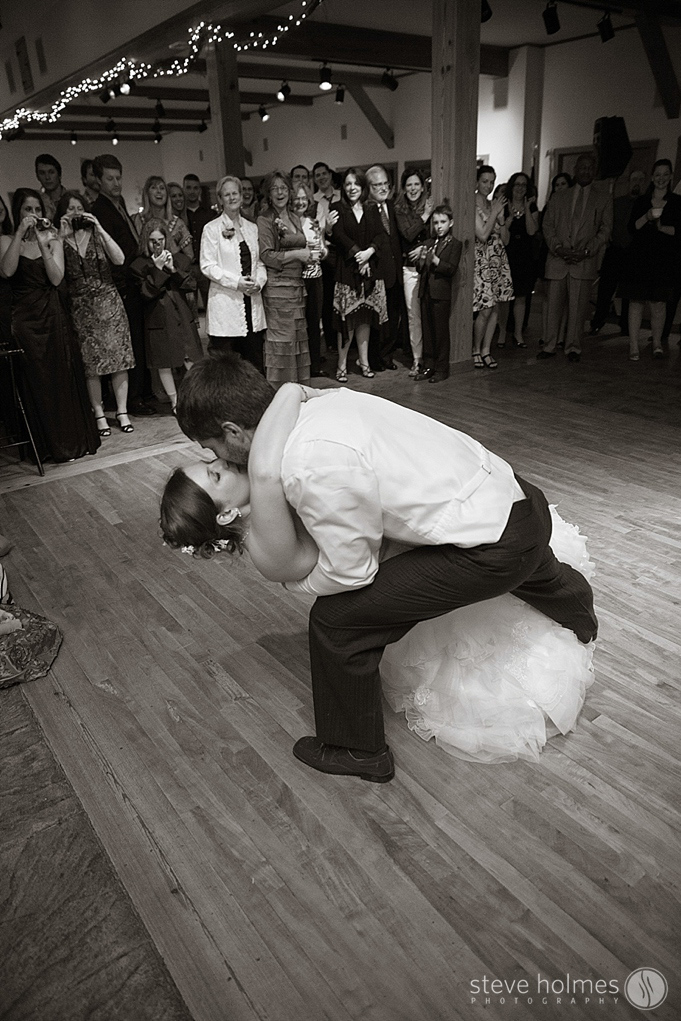 A dip and a kiss at the end of the couples first dance.