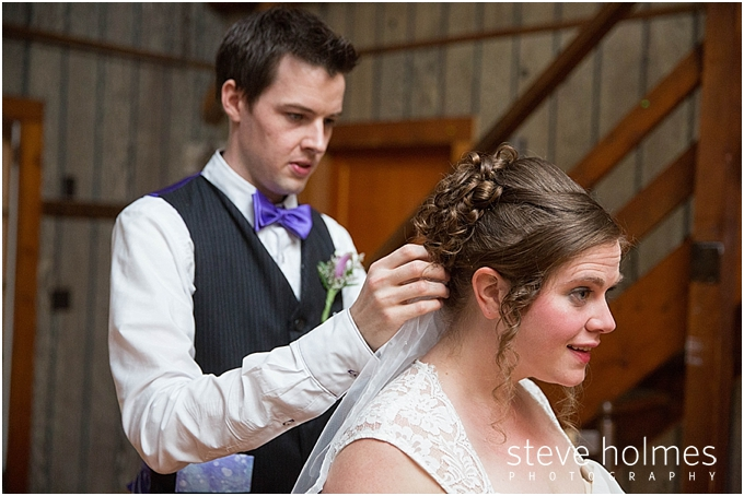 3_Groomsman-helps-attach-veil-to-brides-hair