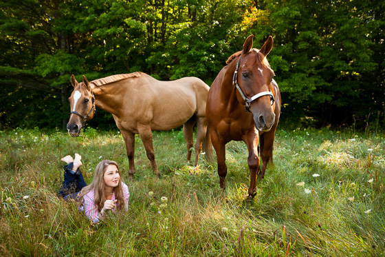 Senior portrait with two horses.