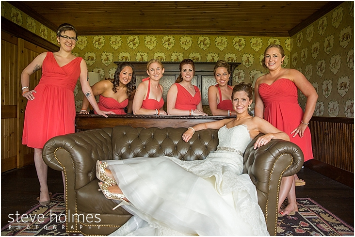 11_bride-on-couch-bridesmaids-behind