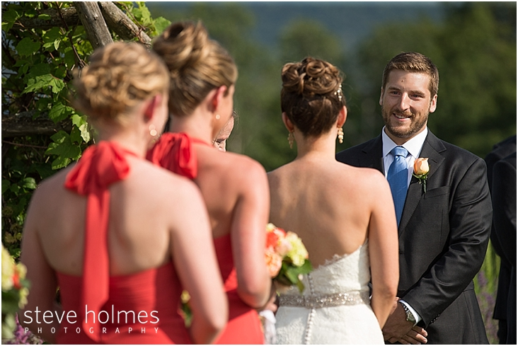 47_groom-smiles-at-bride-during-ceremony