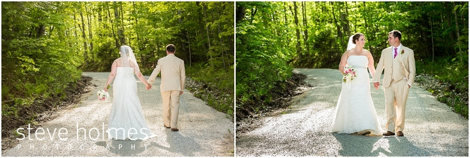 77_bride-groom-hold-hands-path-woods