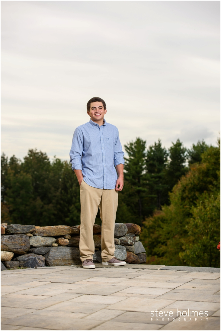 12_boy-standing-in-driveway-at-home-in-nh-for-senior-portraits