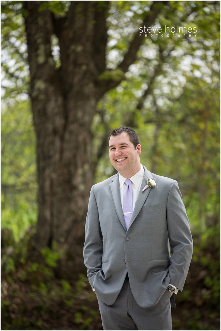12_groom-smiling-in-grey-suit