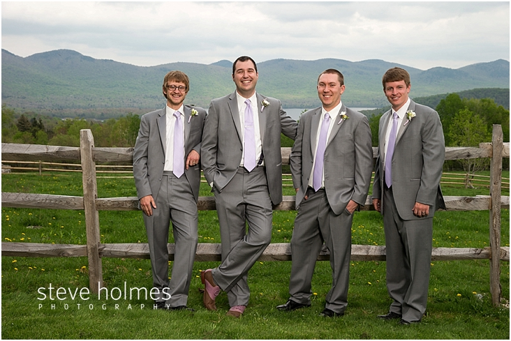 26_groom-and-groomsmen-standing-by-wooden-fence