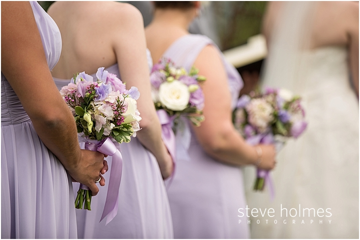 41_close-up-of-bridesmaids-holding-bouquest-during-ceremony