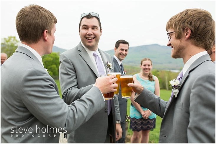 55_groom-and-groomsmen-toast-their-glasses-of-beer