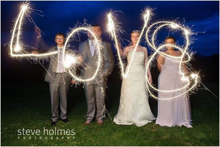 67_bride-groom-bridesmaid-and-groomsmen-spell-love-with-sparklers