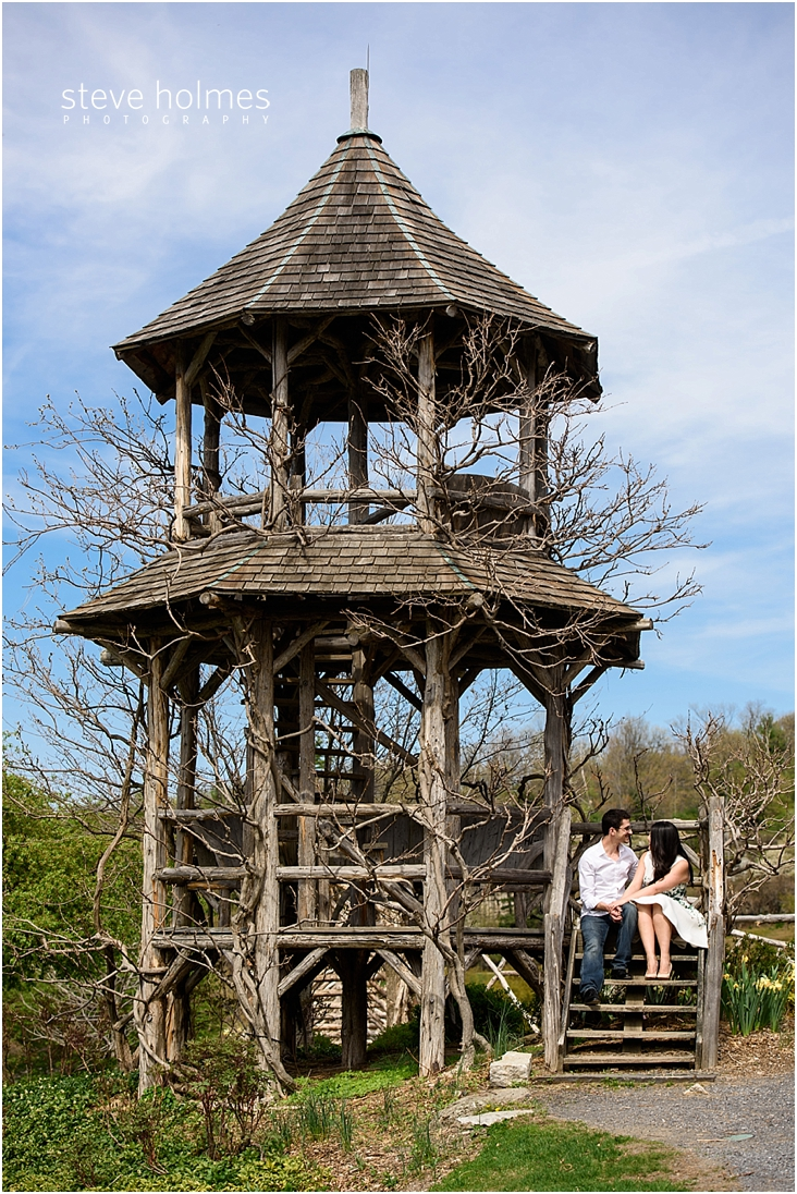 14_happy-couple-sits-on-stairs-of-wooden-gazebo