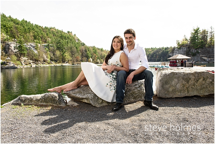 23_happy-couple-sitting-on-large-rocks-with-river-in-background