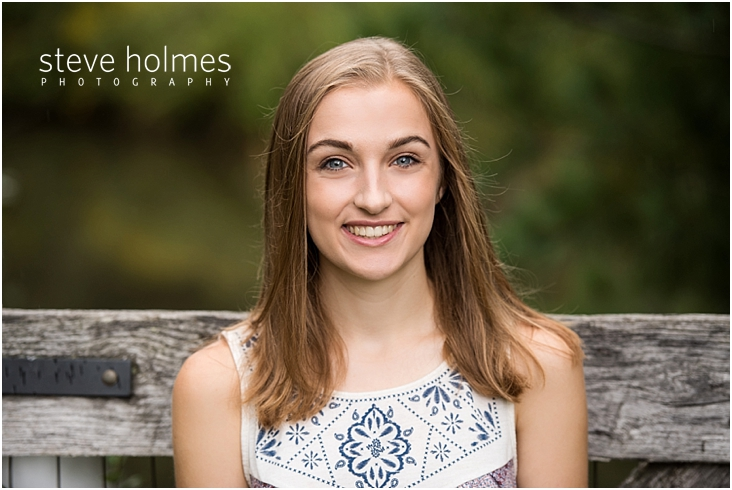 01_Keene-High-School-Senior-Pictures-Outdoors-Wooden-Gate-Blue-and-Red-Patterned-Tank-Top
