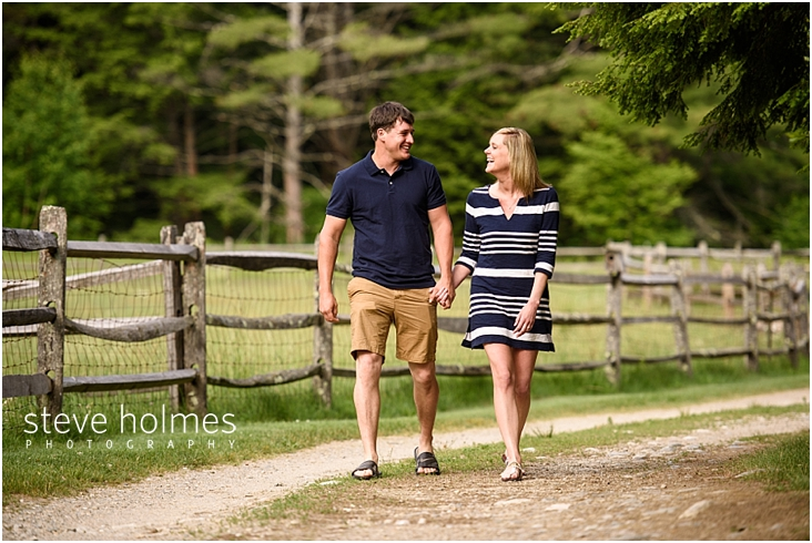 01_couple-walking-hand-in-hand-down-gravel-road
