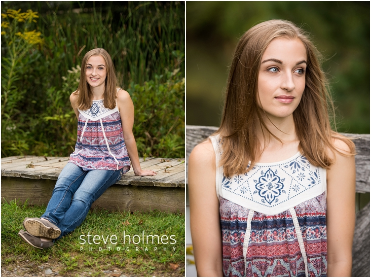 03_Keene-High-School-Senior-Pictures-Outdoors-Wooden-Boardwalk-Blue-and-Red-Patterned-Tank-Top-Jeans
