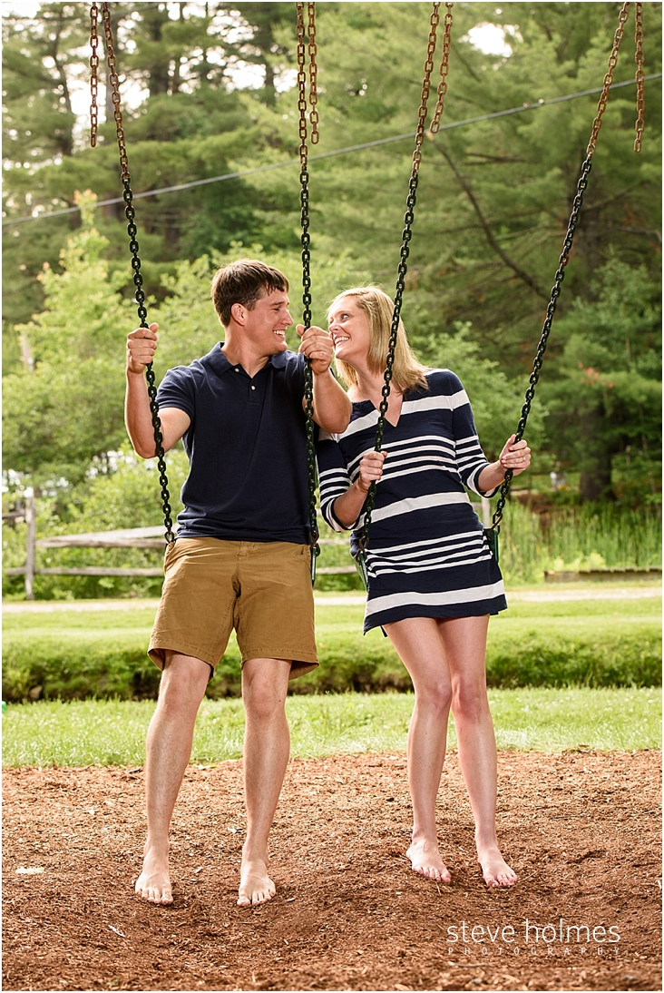 07_couple-smiling-on-swings