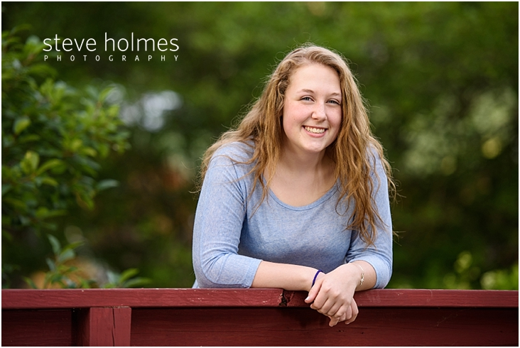09_Keene-High-School-Senior-Pictures-Outdoors-Red-Bridge-Gray-Top
