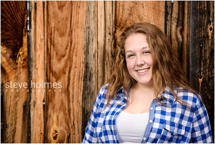 12_Keene-High-School-Senior-Pictures-Wood-Wall-Blue-and-White-Plaid-Shirt